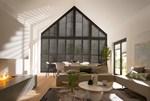 Black coloured shutters that are shaped to fit a gable end window in a living room