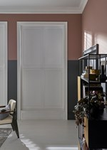 White coloured shutters which are fitted to rectangular windows in a room decorated in blush and grey