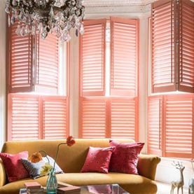 Pink window shutters in living room