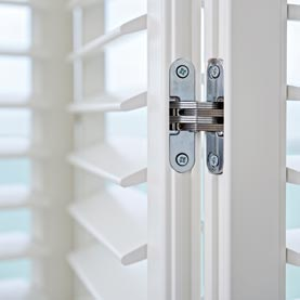 White plantation shutter hinges