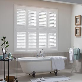 White vinyl shutters in bathroom