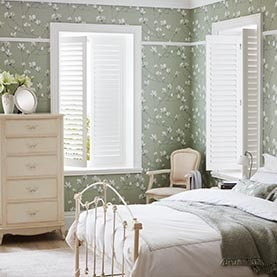 White plantation shutters in bedroom