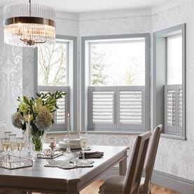 Café style white shutters in dining room