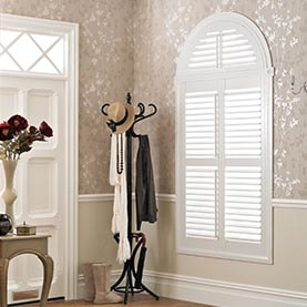 Curved window shutters in hallway