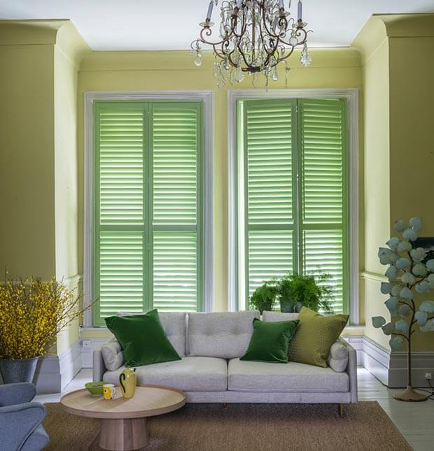 Green full height living room shutters