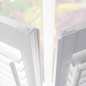 White moisture-resistant bathroom shutters as a close-up