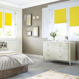 Bedroom shutters coupled with a yellow Duette blind