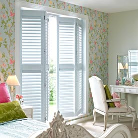 Bedroom shutters in a Laura Ashley shade