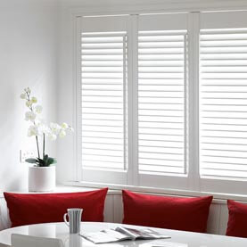 Made to measure dining room shutters on large window