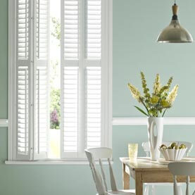 Laura Ashley white dining room shutters