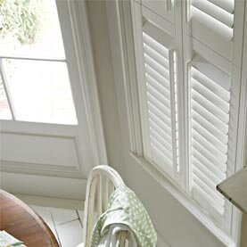 A close-up image of Laura Ashley Ivory plantation shutters in kitchen