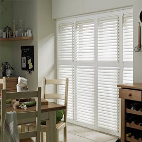 Full height vinyl shutters in large kitchen window