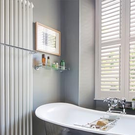 Vinyl shutters next to a bath Laura Ashley vinyl shutters in bathroom Tier-on-tier vinyl shutters in bathroom Close up of vinyl shutter hinges Vinyl shutters covering large kitche nwindow Vinyl shutters over kitchen sink Curved window shape with vinyl shutters Vinyl shutters on conservatory windows