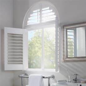 Curved window shape with vinyl shutters