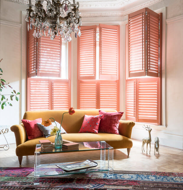 Pink tier-on-tier style shutters in bay window