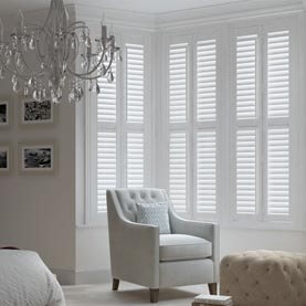 White shutters for a living room bay window