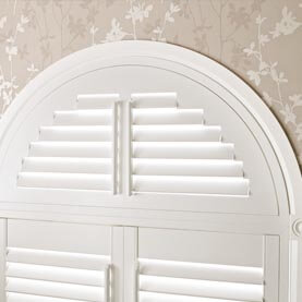 Close up of curved white shutters