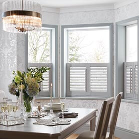 White café shutters in dining room