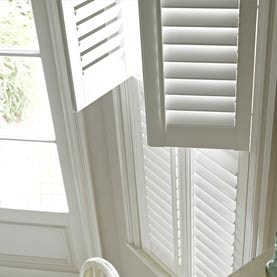 Close up of white tier-on-tier shutters