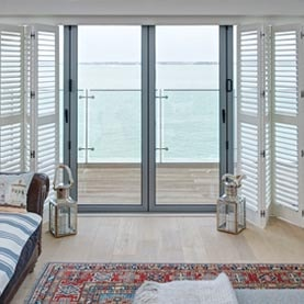 Patio doors with open tracked sliding shutters