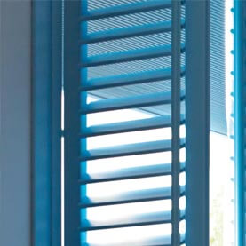Blue blackout shutters combined with a blue blind