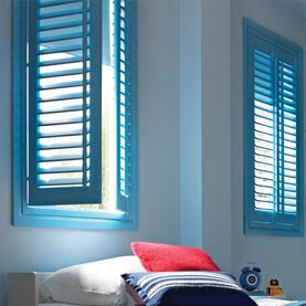A pair of blue blackout shutters in a children's bedroom