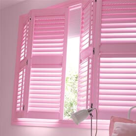 Pink shutters coupled with a pink blind to create an almost blackout effect