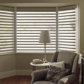 Neutral Pirouette blinds in bay window
