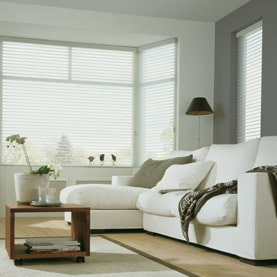 Electric white bay window blinds in living room