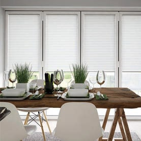 White bi-fold door blinds closed in dining room