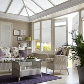 White Conservatory blinds on windows, door and roof