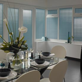Made-to-measure blue metal Venetian blinds in dining room