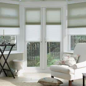Combination of white and beige Twin Shade blinds on French doors