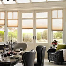 Conservatory showing French door blinds on wood