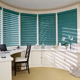 Green Pirouette blinds across curved wall