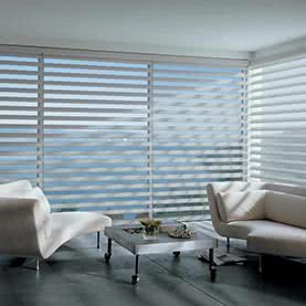 Electric Pirouette blinds across large window