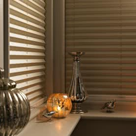 Close up of corner window dressed with pleated blinds