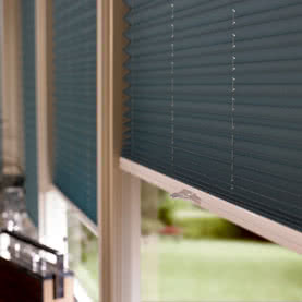 Close up of dark pleated blinds