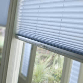 Close up of light blue pleated blind