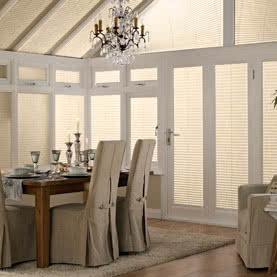 Cream Pleated blinds in conservatory window, doors and roof