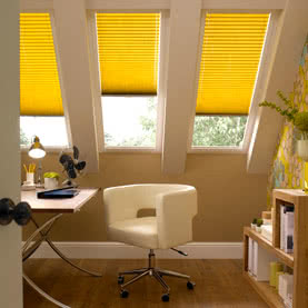Yellow Pleated blinds on Velux windows