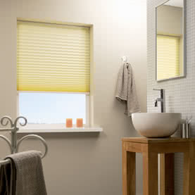 Yellow pleated blind in bathroom