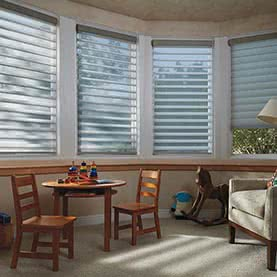 Four blue Silhouette blinds across large bay window