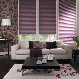 Three purple Silhouette blinds in living room