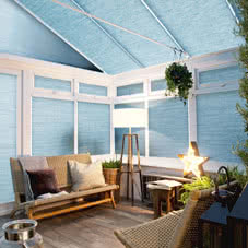 Light blue thermal blinds on conservatory roof and windows