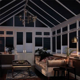 Conservatory with Twin shade black and white blinds across windows and roof
