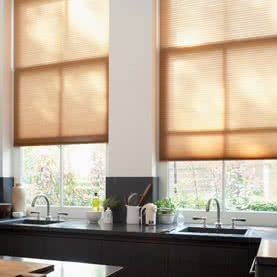 Neutral Duette and Pleated blinds above kitchen sink