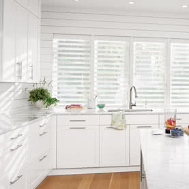 Open white Silhouette blinds above kitchen sink