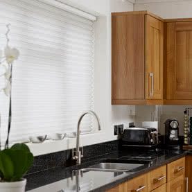 White Duette closed blind fitted above kitchen sink