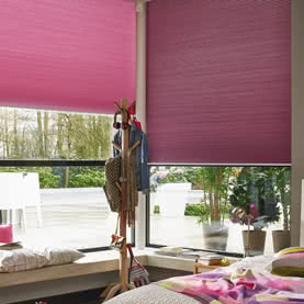Purple Duette blinds half open in bedroom